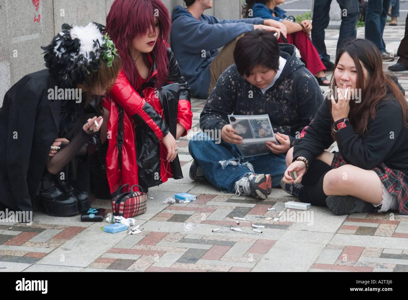 Goth teenage girls and cigarette butts on a Sunday afternoon, Harajuku bridge at the entrance to Yoyogi Park, Tokyo, Stock Photo