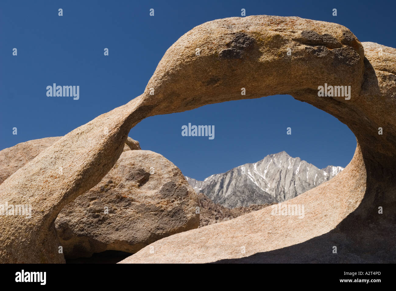 Natural arch at the Alabama Hills frames Lone Pine Peak in the Eastern Sierra Nevada Mountains, California, USAStock Photo