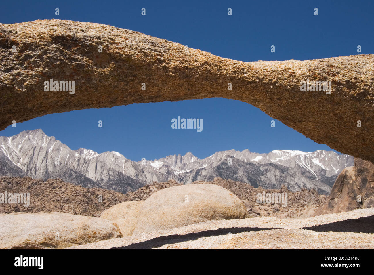 A natural arch in the Alabama Hills near Lone Pine frames Mount Whitney and the crest of the Sierra Nevada Mountains,Stock Photo