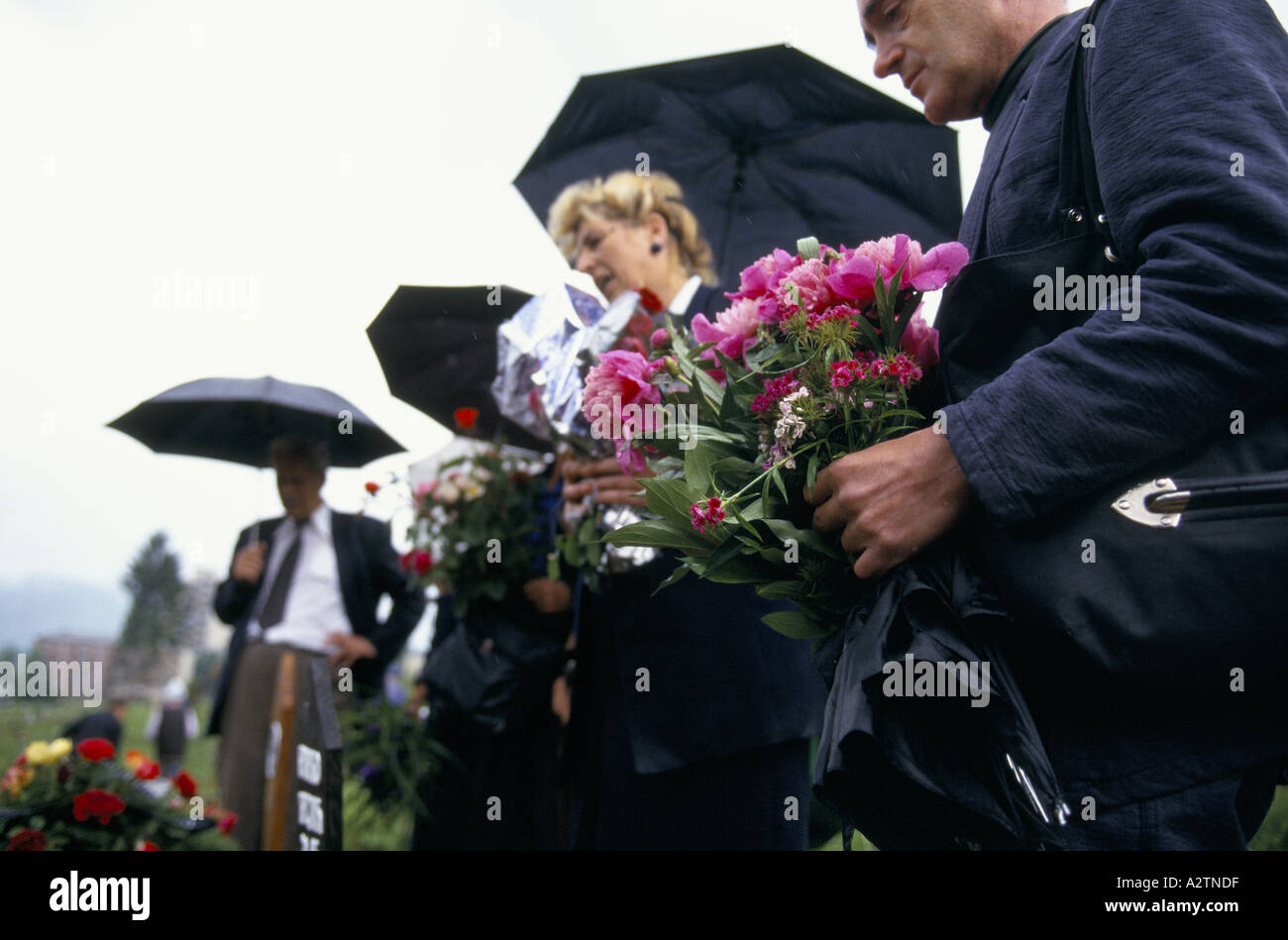 Sarajevo June 1995 Mourners In Black With Flowers At A Funeral Stock
