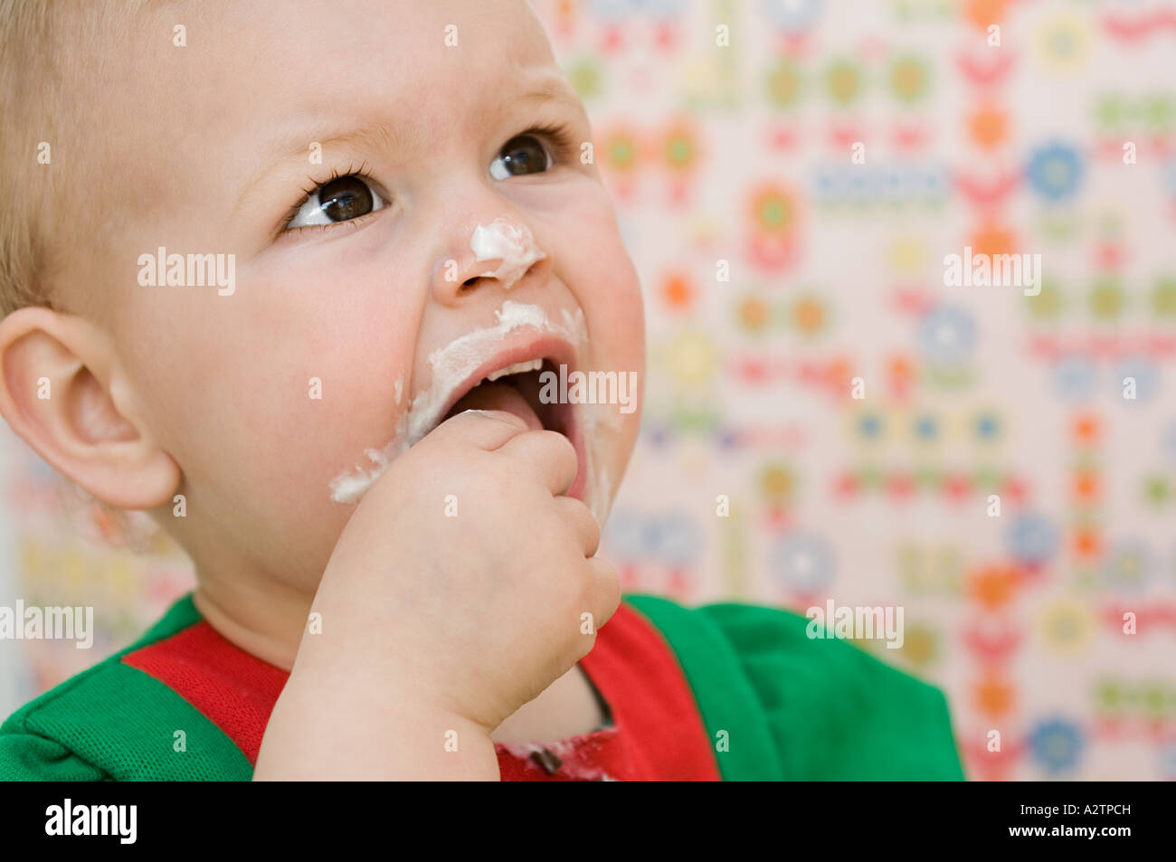 Baby with a messy face - Stock Image