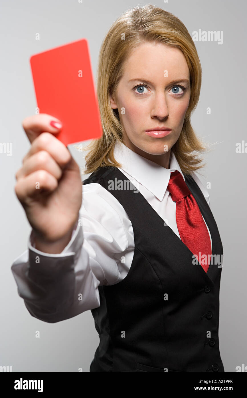 Woman holding red card - Stock Image