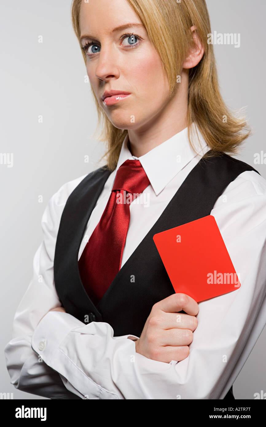 Businesswoman holding red card - Stock Image