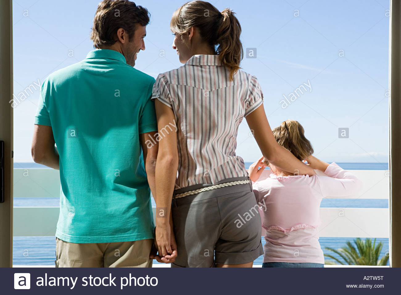 Family standing on a balcony - Stock Image