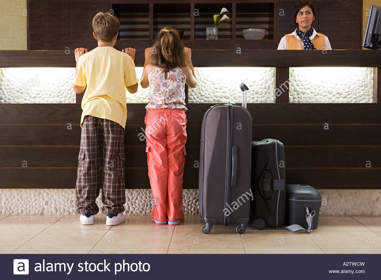 Children at a hotel reception - Stock Image