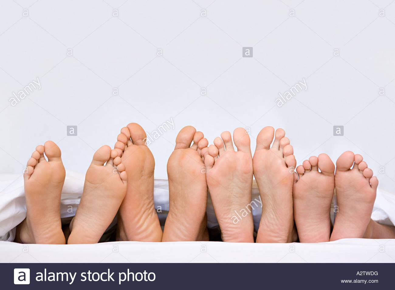 A row of bare feet Stock Photo