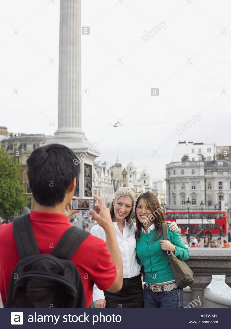 Tourists having photo taken - Stock Image