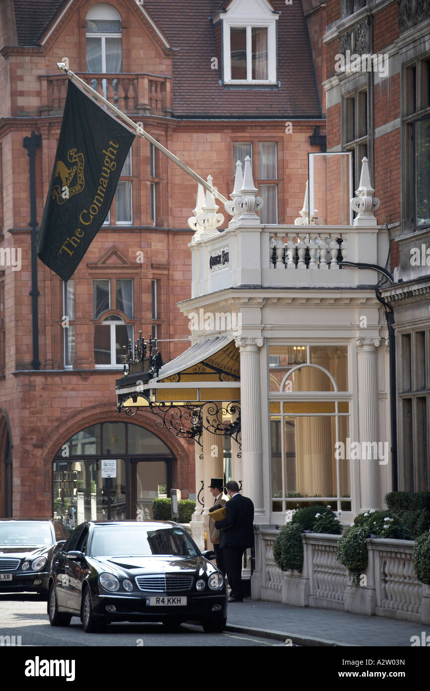 People with Doorman and Mercedes limousine outside the Connaught Hotel in Mayfair London W1 England - Stock Image