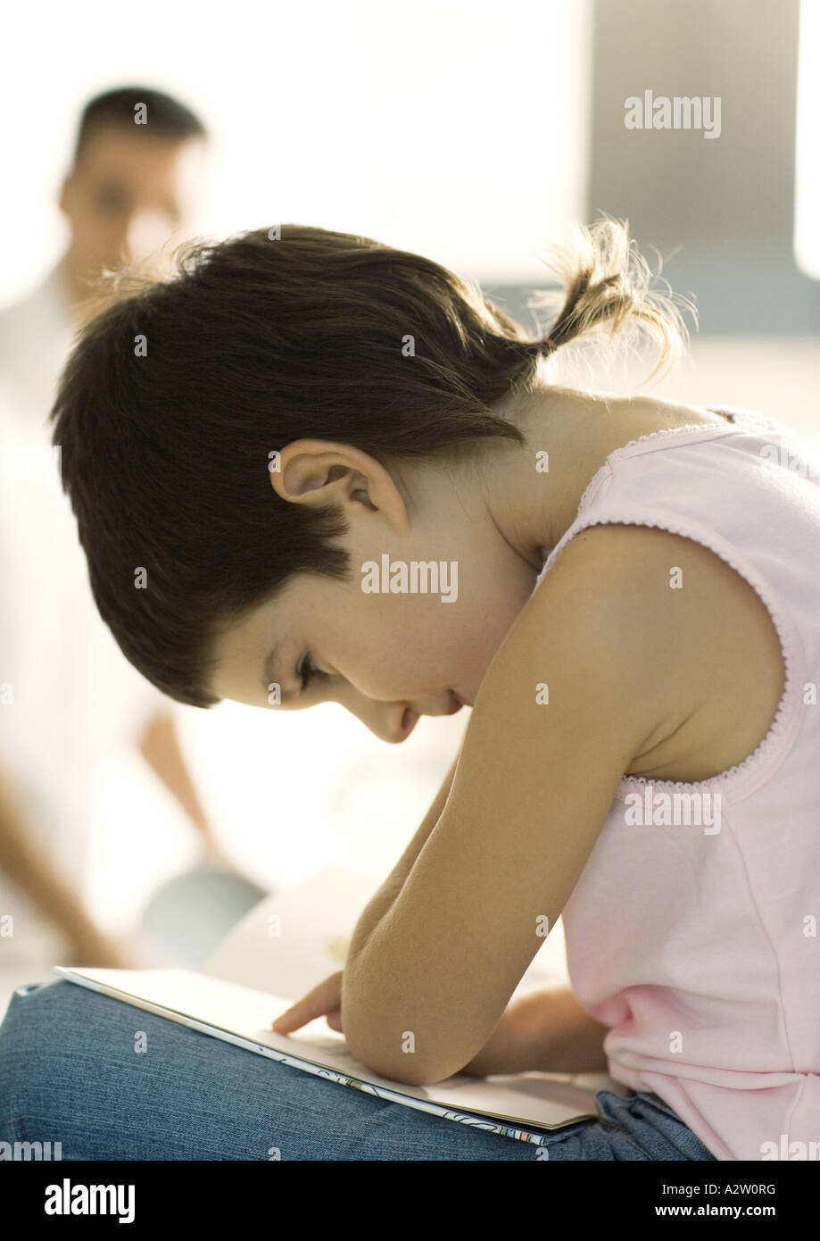 Child reading book - Stock Image