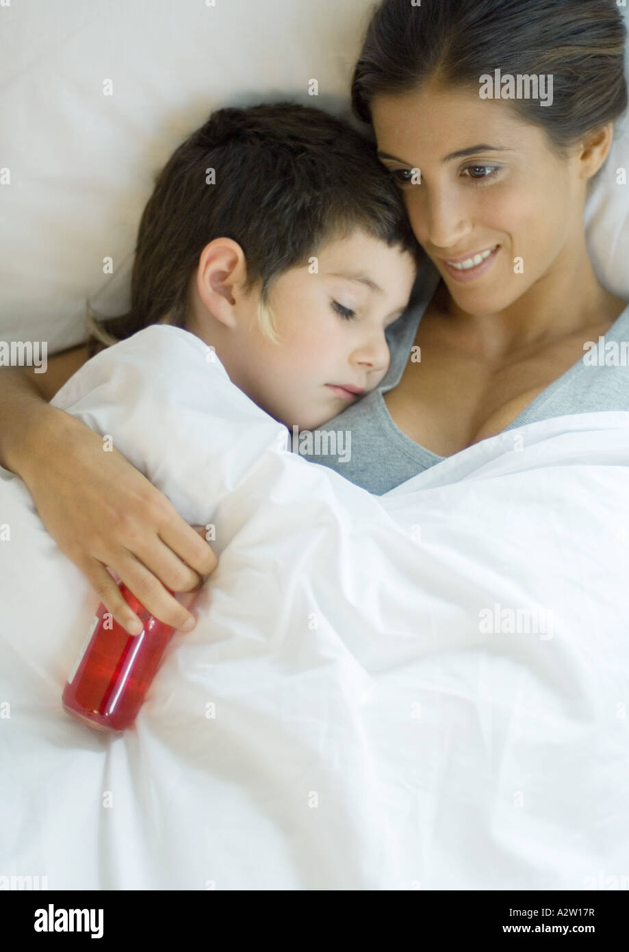 child lying down with head on mother s shoulder mother holding