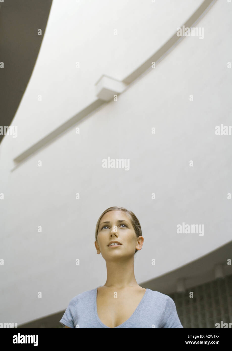 Woman, head and shoulders, low angle view Stock Photo
