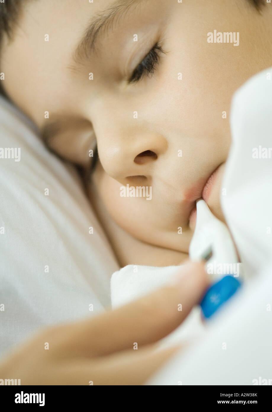 Child having temperature taken Stock Photo