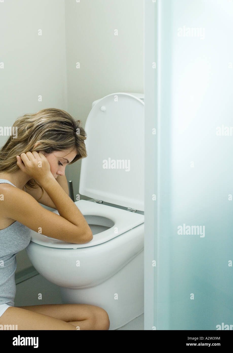 Young Girl Sitting On Toilet Stock Photos & Young Girl Sitting On ...