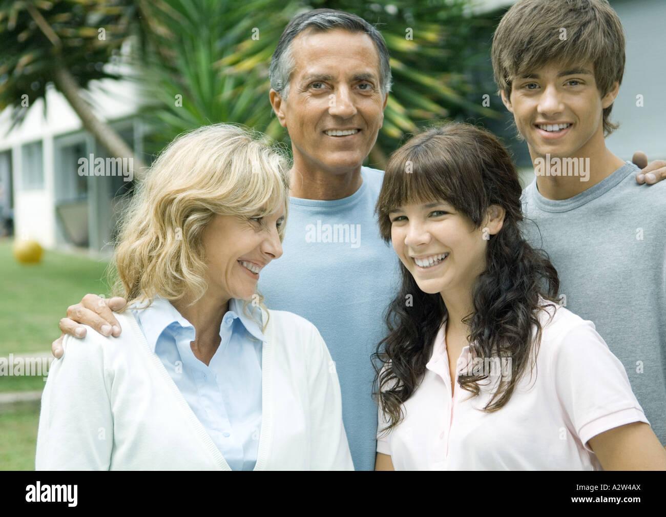 Mature couple with teenage grandchildren - Stock Image