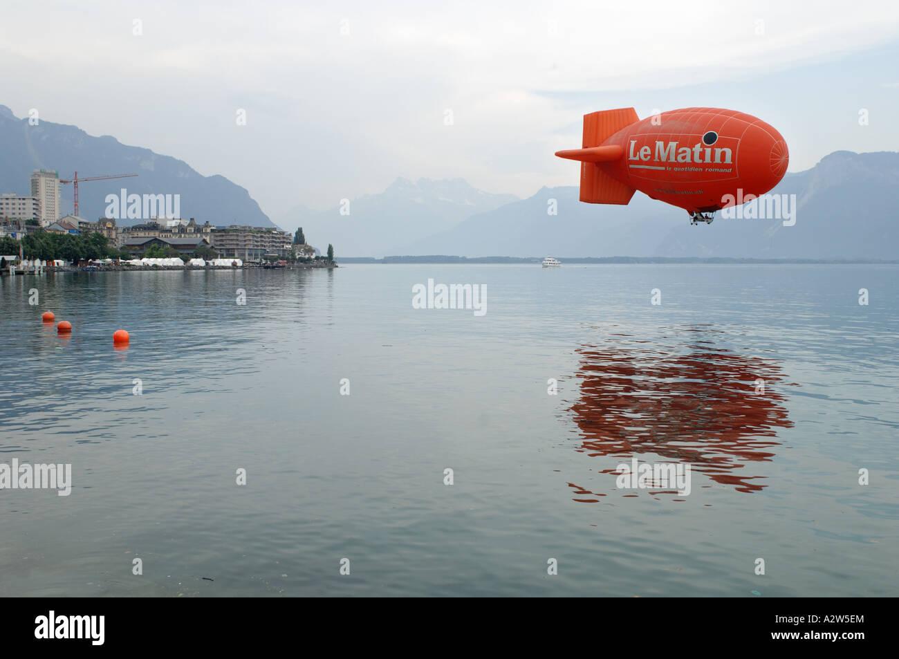 Le Matin airship over Lake Geneva Vevey Switzerland Stock Photo
