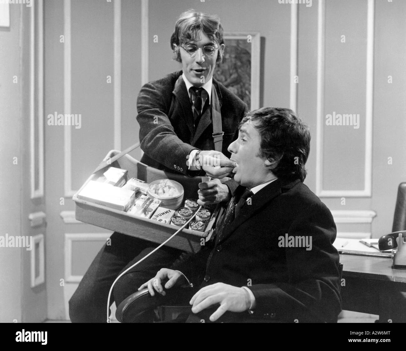 PETER COOK left and Dudley Moore - UK comedians on their TV show in 1968 - Stock Image