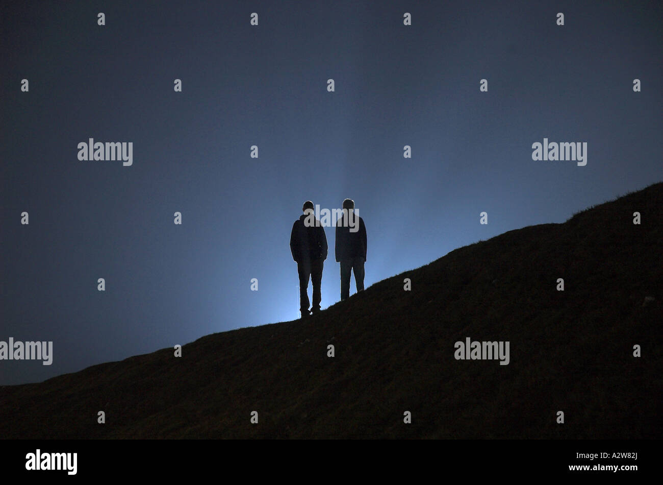 sci-fi silhouette of two humans - Stock Image