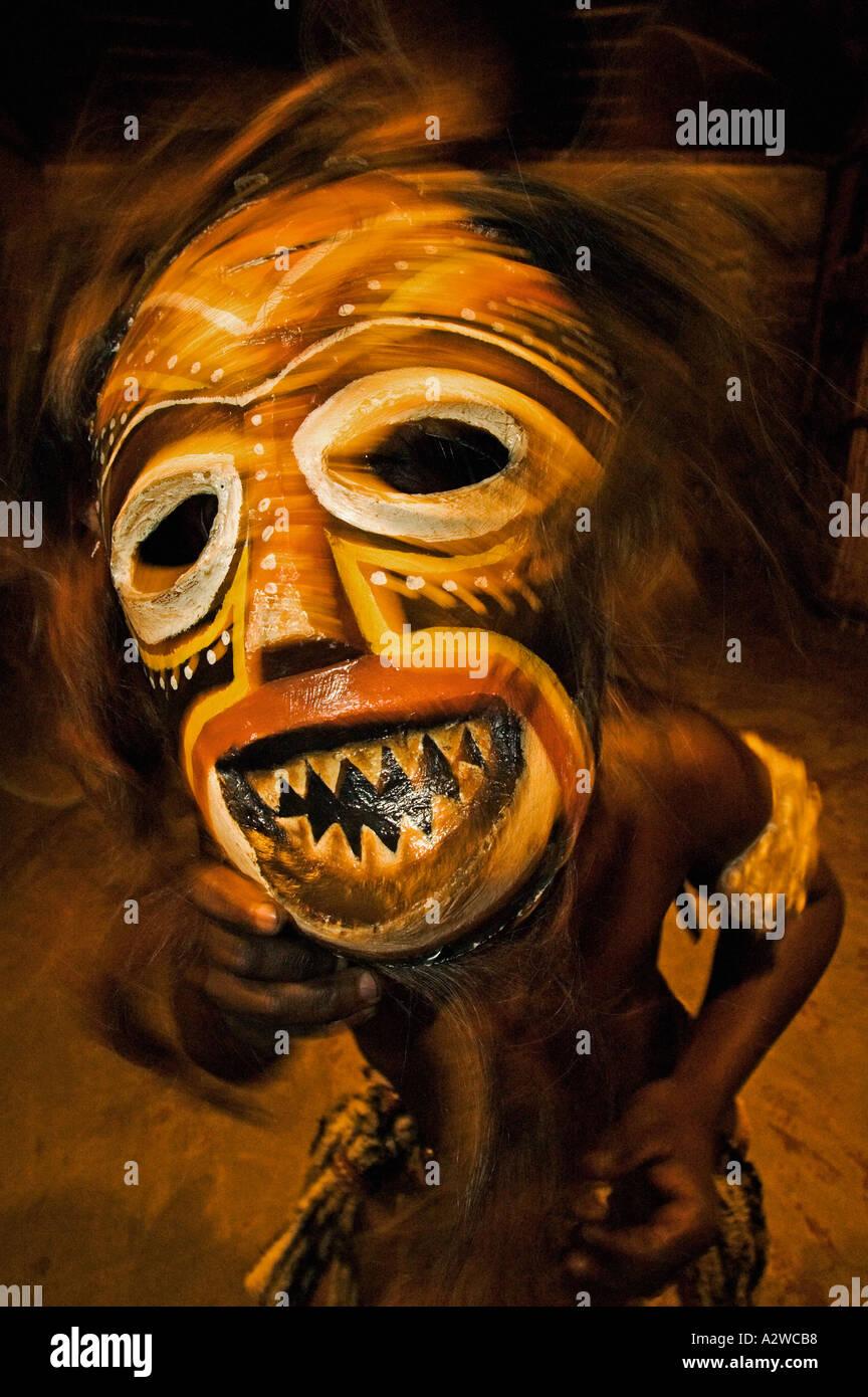 Dancer in Tokolosh mask African masks depict spirits of ancestors
