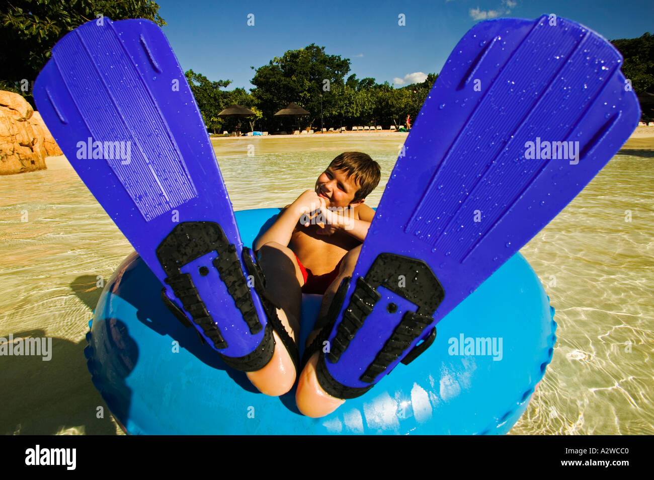 People 8 year old child in water tube with flippers Model released Sun City South Africa - Stock Image