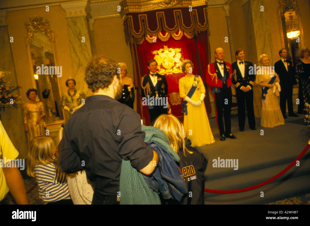 madame tussauds london visitors looking at wax works of the British royal family - Stock Image