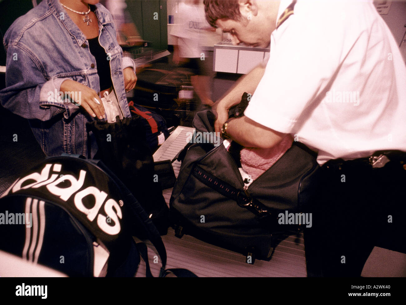 passenger bag being checked manchester airport - Stock Image