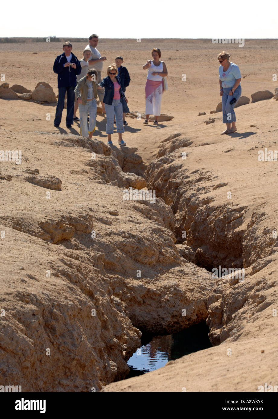 Tourists look at Earthquake damage in Ras Mohamed National Park, Sharm El Sheikh in Egypt - Stock Image