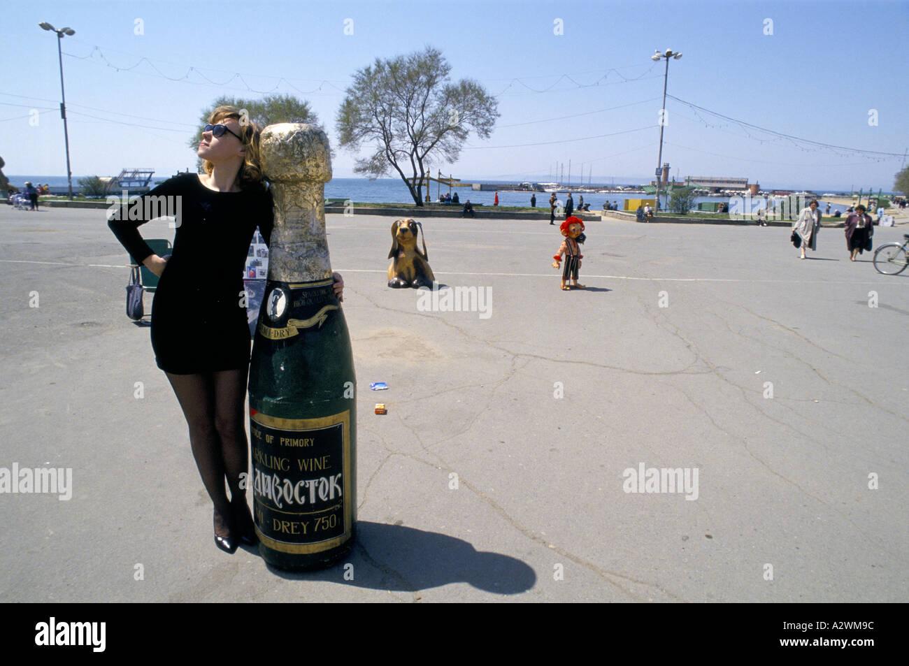 New capitalist, Margaritte Akimoushkina poses for pictures at nabevshnai beach, Vladivostock. - Stock Image