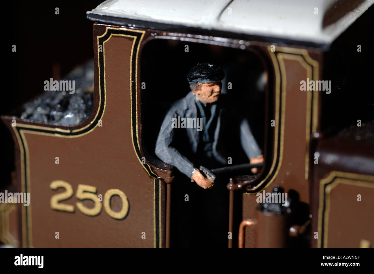 Close up of a train driver on a model railway set Stock Photo