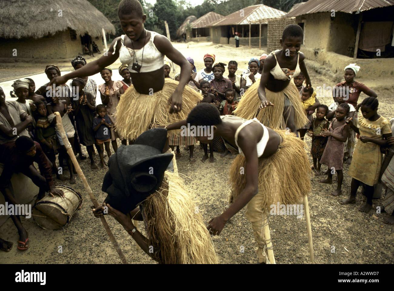 Children wearing grass skirts making traditional dance. Kailahun, Sierra Leone, Africa - Stock Image