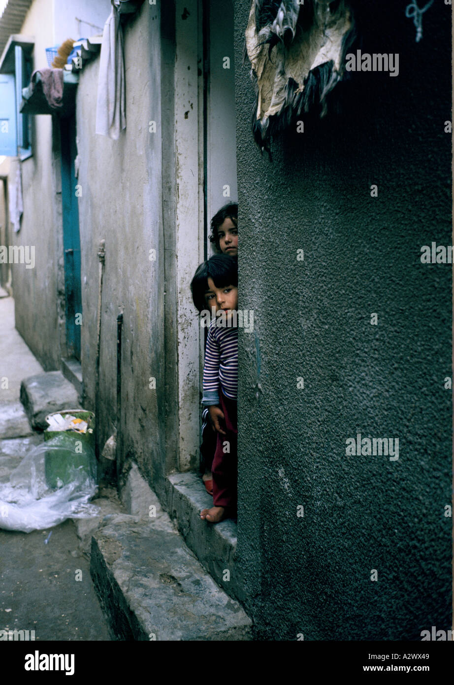 Children at the doorway of their home at Beach (Shatti) refugee  camp, Gaza, Israeli Occupied    Territories, 1987 - Stock Image