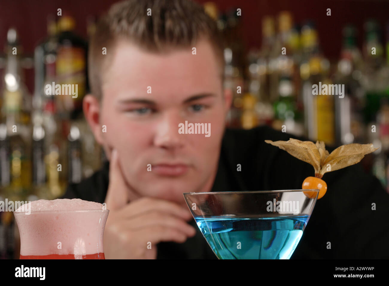 Barman checks cocktails The Cocktails from the left Planters Punch Blue Lady Stock Photo