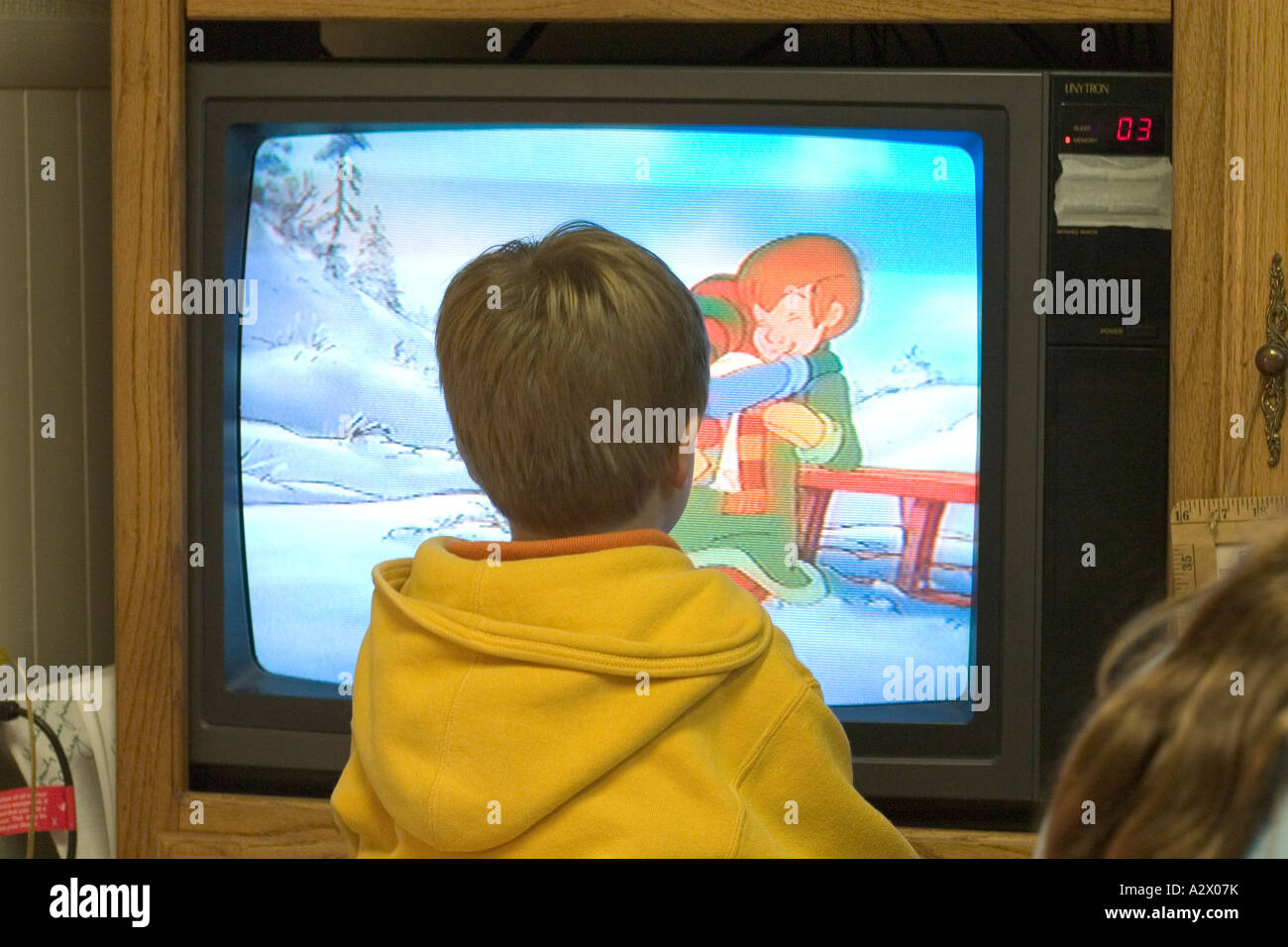Boy age 5 watching cartoons on TV. Downers Grove Illinois IL USA - Stock Image
