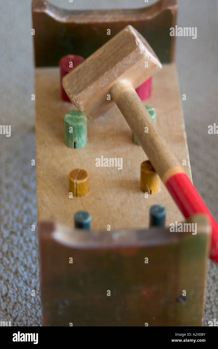 Child's pegboard workbench. Business Concept - Uniformity fitting round pegs in round holes. Plainfield Illinois - Stock Image