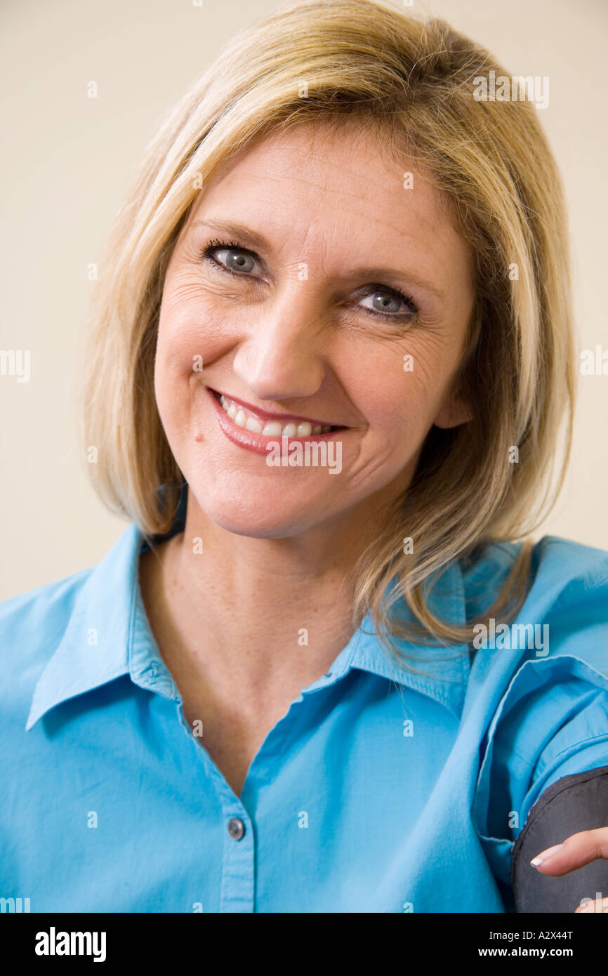 Female patient having her blood pressure measured (taken) during an exam. - Stock Image