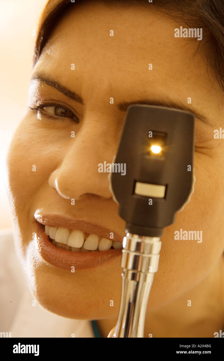 An ophthalmoscope is an instrument used to examine the retina and vitreous of a patients eye. - Stock Image