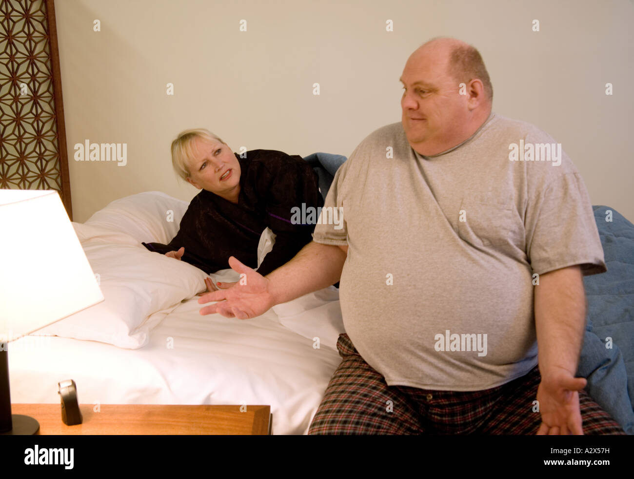 Husband is upset that he can not get to sleep. - Stock Image