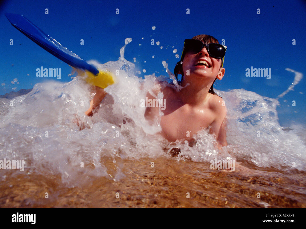 Close-up of boy child playing in wave. Stock Photo