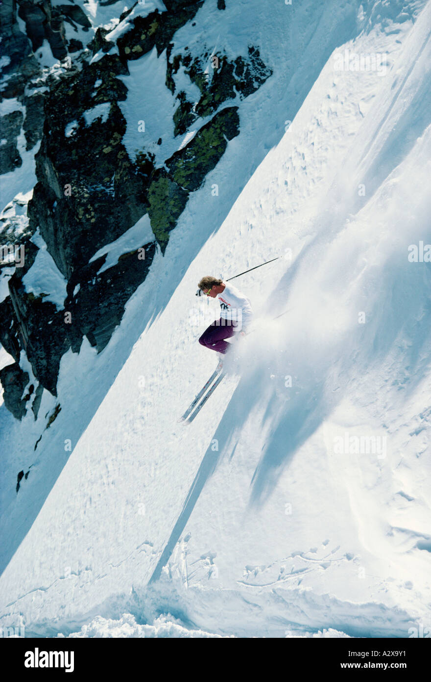 Young man downhill skiing. Stock Photo
