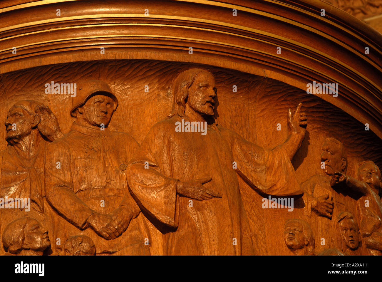 Carving of Jesus next to Nazi era soldier on pulpit of Berlin church - Stock Image