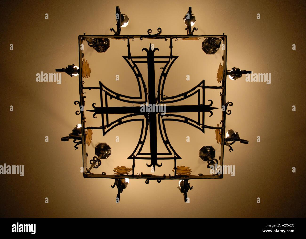 Iron cross shaped chandelier in Nazi era church, Berlin - Stock Image