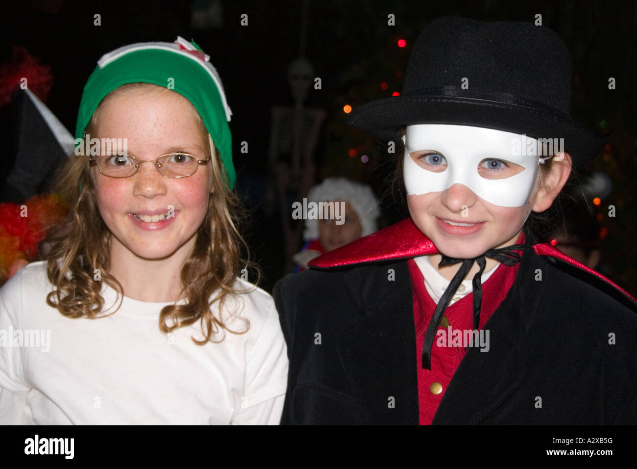 Halloween trick or treaters in masked Zoro character and sister in white angle costume age 6. St Paul Minnesota - Stock Image