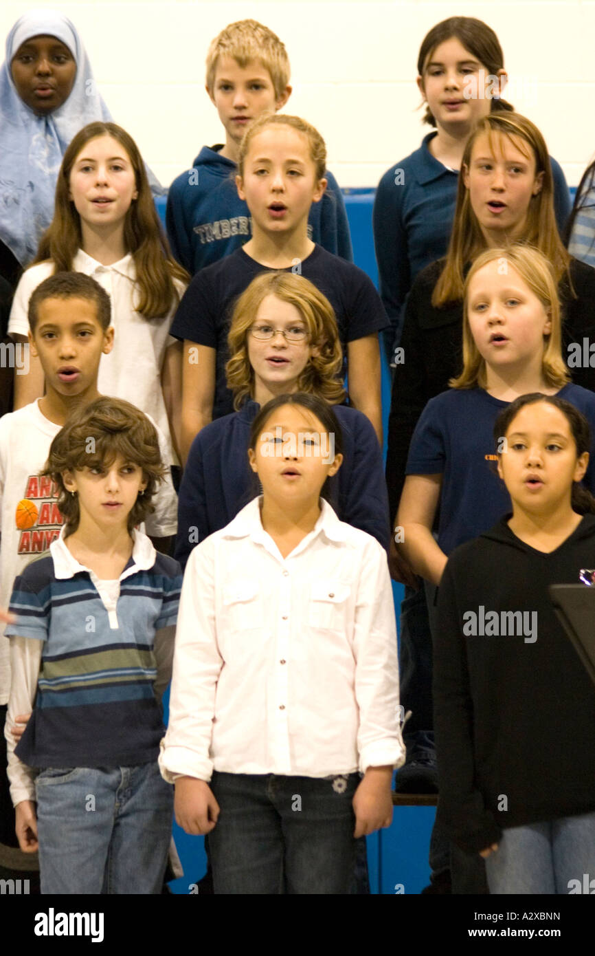 Racially mixed children's chorus age 9. Hurricane Katrina benefit concert - Horace Mann School. St Paul Minnesota - Stock Image