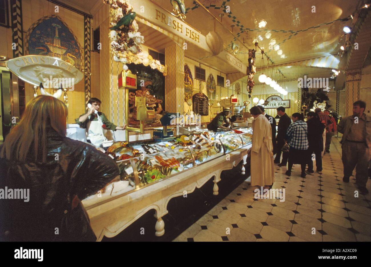 Fish Monger at Harrods Foodhalls - Stock Image