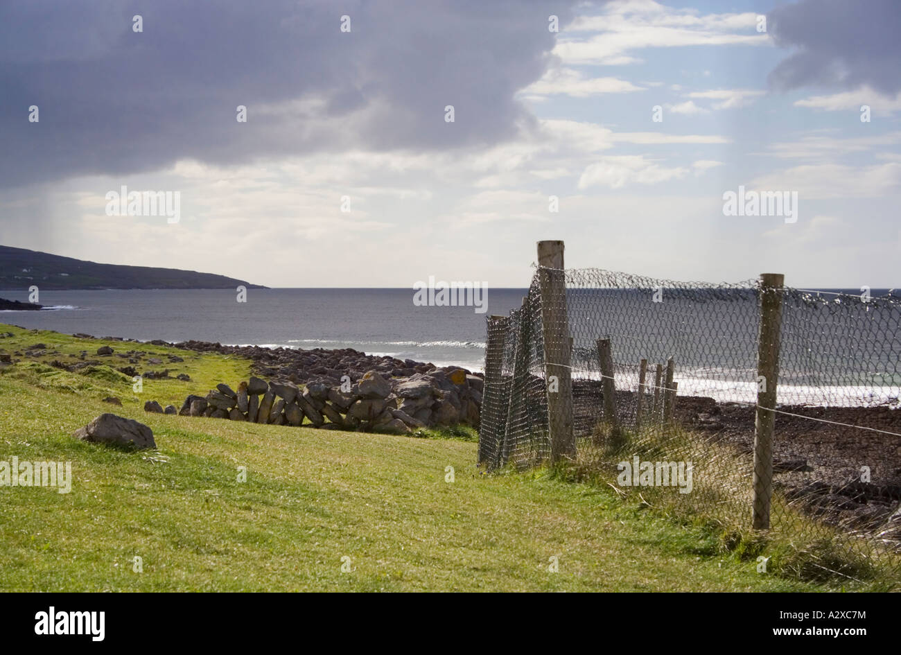 Fanore beach. County Clare. West Coast of Ireland. Rain clouds. Bad weather. - Stock Image