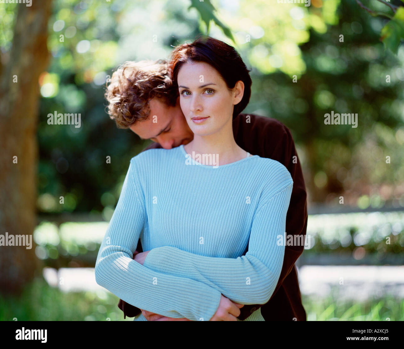Young couple outdoors in the park. - Stock Image
