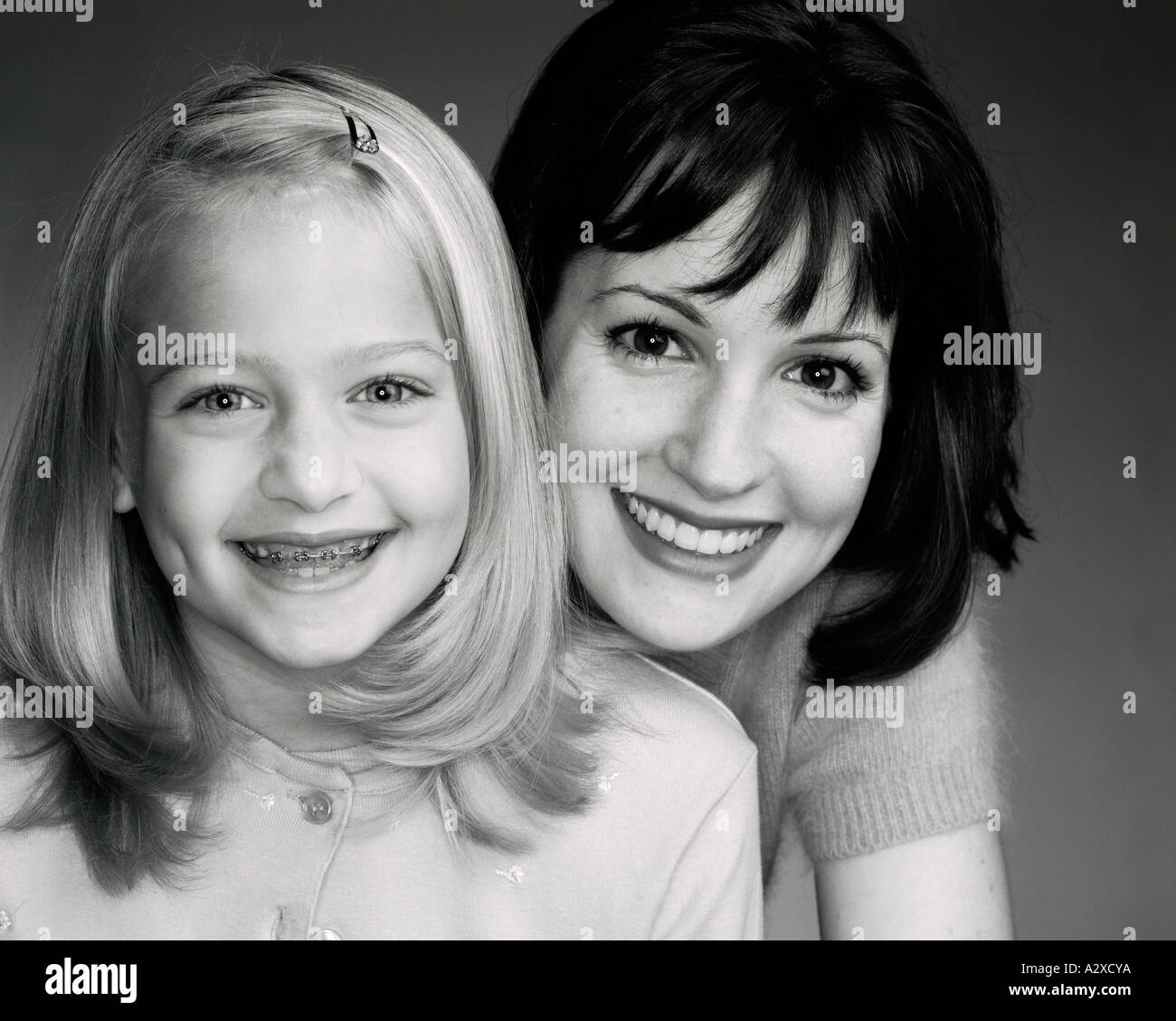 Studio portrait of mother and daughter. - Stock Image