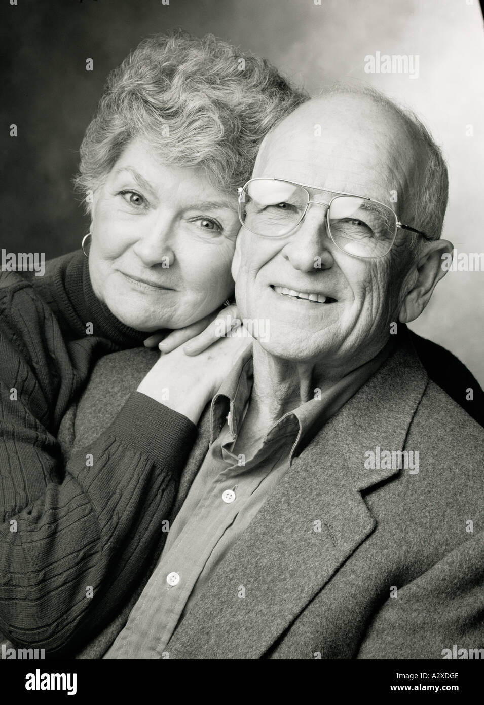 Black and white photograph portrait of retired couple. - Stock Image