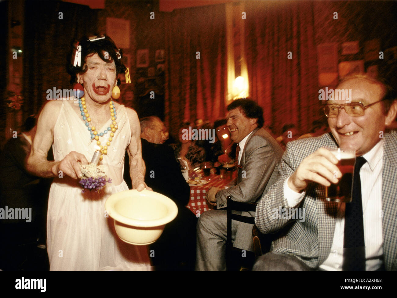 drunk man in drag at christmas party blackpool stock image - Drunk Christmas
