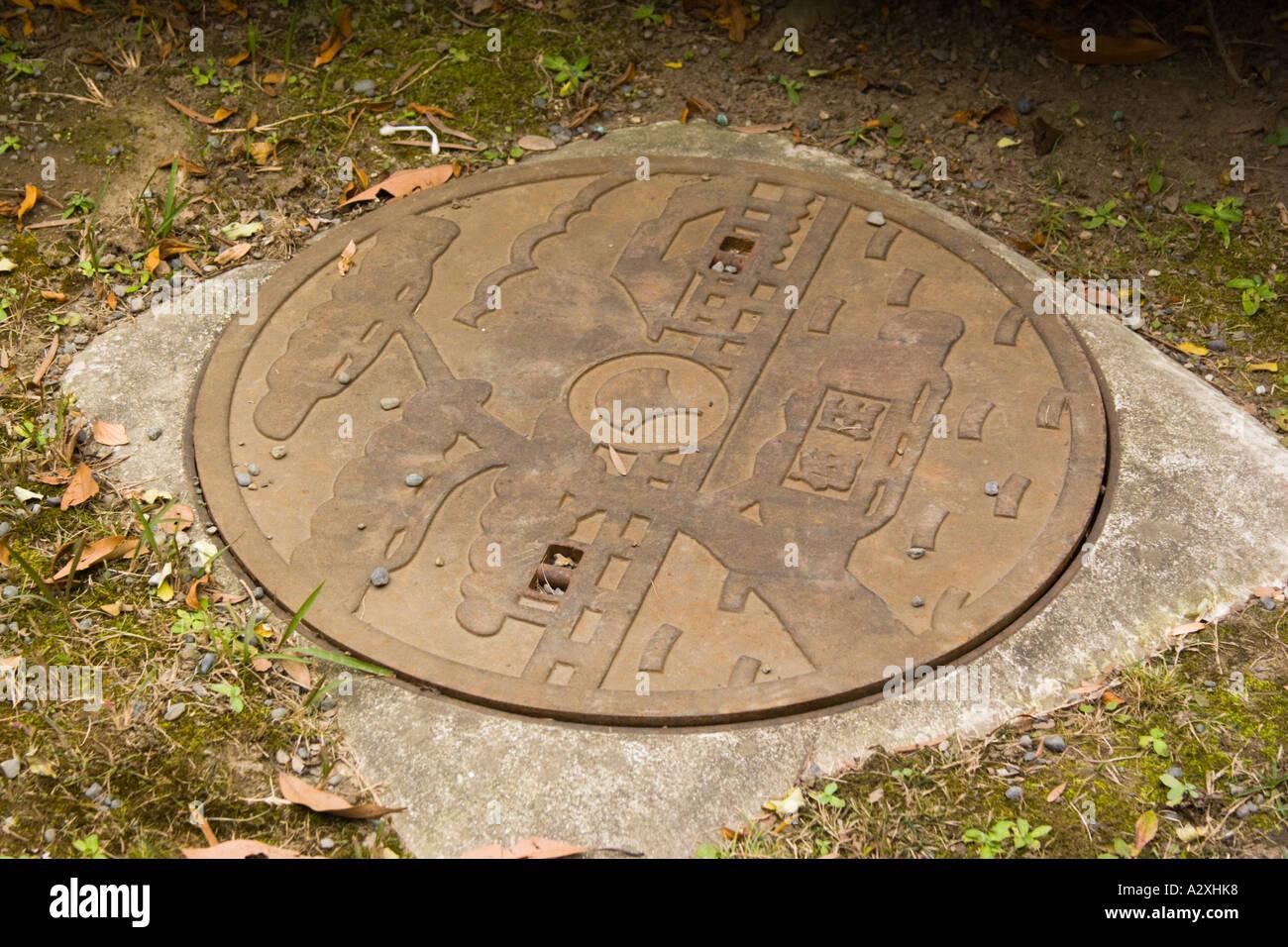 Tokyo Japan Hamarikyu Garden Near The Sumida River Cast Iron Drain Man Hole  Cover   Stock