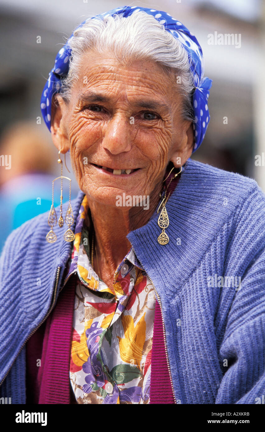 FRANCE Colorful dressed Gypsy lady smiling at the camera - Stock Image